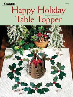 Quilting - One simple holly leaf creates the wreath design on this pretty table topper. Pick a batch of assorted green prints to make the holly-leaf fusible appliqués and a handful of pretty red buttons for the berries. Size: x Skill Level: Easy - Christmas Quilting Projects, Christmas Patchwork, Christmas Placemats, Christmas Runner, Christmas Sewing, Christmas Makes, Christmas Crafts, Xmas, Christmas Patterns