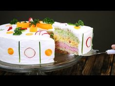 """Swedish sandwich cake: By the time you get to lining the springform pan with white bread, this Scandinavian cake is almost """"baked."""" Oh, that's going to be fluffy and creamy!"""