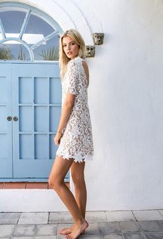 Whether you want a short wedding dress or a fashionable reception alternative, this lace shift dress with short sleeves is a playful option. Reminiscent of 1960s cool, this lace shift can be simply styled with a pair of flats or sandals.