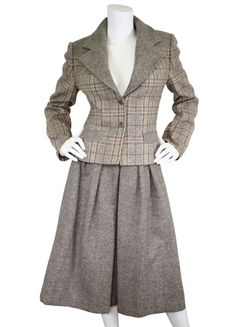 Emilio Pucci 1970's beige tweed skirt suit. Available on Featherstone Vintage.