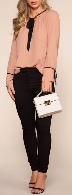 Blush pink top with black detail, black skinny pants, sandals and bag...this is a stylish outfit for work.
