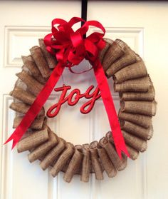 """Handmade Burlap Christmas Wreath with Big Red Bow and """"Joy"""" Hanging in Center on Etsy, $30.00"""