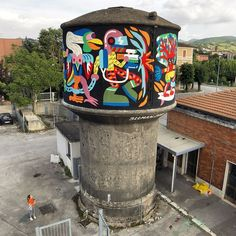 "Artrebels, This mural is called ""The Evolution Chain"". It's my own interpretation of Darwin's theory... It was made on the water tank of  Fabriano's (Italy) train station for the PopUp festival."