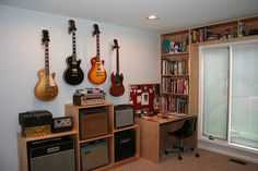 good idea for our music room - do built-ins around the windows for storage/sheet. - good idea for our music room – do built-ins around the windows for storage/sheet music/CDs - Home Studio Musik, Music Studio Room, Guitar Wall, Guitar Room, Home Music Rooms, Music Bedroom, Guitar Storage, Office Music, Band Rooms
