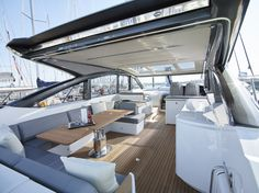The main deck seating and dining area on board the Princess V58 Open sports yacht #craftedinplymouth #yacht