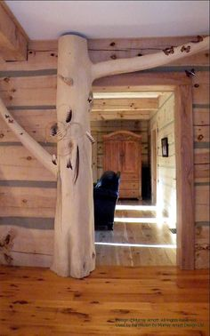 An opening detail from a dovetail log home (with chinking) in Ontario. For more photos or this or any other or my homes, please check out my website, www.designma.com, my Design Page, www.facebook.com/loghomedesign #loghomes #loghomedesign #handcraftedloghomes #dovetail