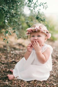 Sweet little girl with flowers in her hair