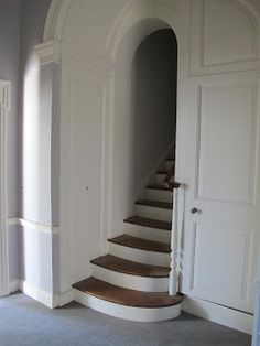 Small hidden staircase for access to kids bedrooms upstairs.  Just outside lower master.