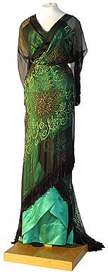 This dress shows the influence of the artistic movements of the time in its neo-classic form and art nouveau pattern. Russian c. 1910. by Lamanova.