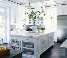 From thefoodogatemyhomework: Fabulous kitchen by Steven Grambel Design featuring white faux bamboo Chinese Chippendale stools at the island aaand chairs at the table - because you can never have enough. Simple lovely white cabinetry and  beautiful Carrera marble, grey-blue subway tile backsplash, coffered and bead-boarded white ceiling, high hung milk glass and steel pendants. Love the old school stainless subzero and the leaded glass window and french doors are stunners.