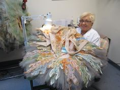 Seamstress at Miami City Ballet works on the lead dream scene ballerina's tutu.