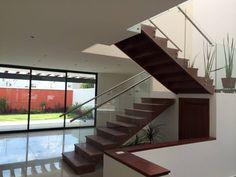 Vestíbulo: Pasillo, hall y escaleras de estilo Moderno por Ambás Arquitectos