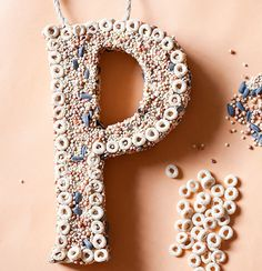 Wooden or paper mache letter + twine for hanging + peanut butter + bird seed + Cheerios = Cute decorative bird feeder