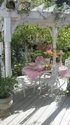 Decoration: Awesome Bright Spring Terrace And Patio Décor Ideas With Pink White Dining Table Chair And Pink Flowers Ornament And Metal Patio Chairs Plus Wooden Flooring Design Ideas: Awesome Bright Spring Terrace And Patio Décor Ideas