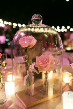 beauty and the beast inspired wedding table center piece for an outside evening summer wedding