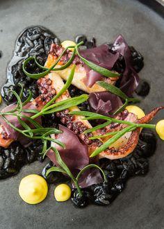 Octopus, 'black rice', saffron by Paul Welburn