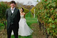 """First look"" in the vineyard. Wedding portraits at Jonathan Edwards Winery, CT."