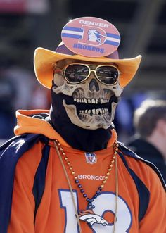 A Denver Broncos fan arrives early for the NFL Super Bowl 50 football game between the Denver Broncos and the Carolina Panthers on Sunday, Feb. 7, 2016, in Santa Clara, Calif.