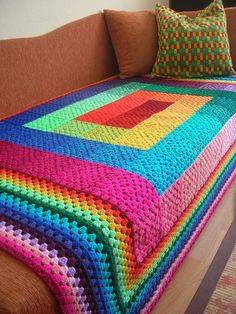 makes me want to make a blanket.   Full Spectrum Granny Square Blanket Made of 63 different coloured granny squares All these colours are blended in rainbow order starting from the middle creating a swirl and they never repeat