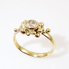 Bubble wedding ring of gold with champagne diamond OOAK by Castens, $1280.00  This is my own design, which I pinned directly from Etsy. Its my new favorite, because the stone is so fabulous!