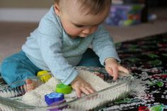 Rice, Rice, Baby - Rice makes a neat swishy sound and is safer than sand for babies who put everything (and we mean everything!) in their mouths. Just add some wooden toys and your tot will be occupied for a good chunk of time.