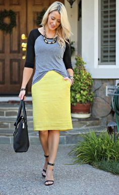 love a casual/unexpected shirt with a skirt <3