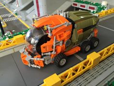 https://flic.kr/p/JwA3hh | FUALee Garbage Trucks | Built for the busy streets, these Garbage trucks are the backbone of the waste disposal unit in Bucharest.   --  Built for Keith's A Bus Stop In Bucharest Collaboration.