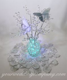 hollywood glam feather centerpieces   centerpiece is made with acrylic crystal prism sprays, silver feather ...