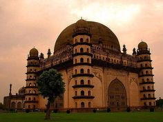 "Gol Gumbaz, Bijapur District, Karnataka Province/State, India. Gol Gumbaz is the mausoleum of Mohammed Adil Shah, Sultan of Bijapur. The tomb, located in Bijapur, Karnataka in India, was completed in 1656 by the architect Yaqut of Dabul. Although ""impressively simple in design"", it is the ""structural triumph of Deccan architecture""."