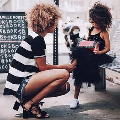 Mother and daughter wearing black and white stylish outfits