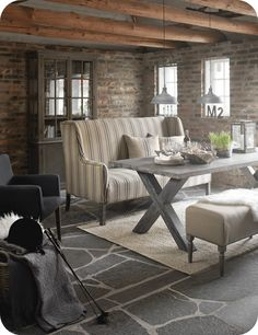 brick walls, wooden beams, & slate floor = beautiful room