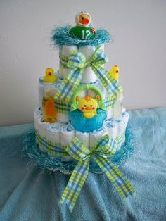 Diaper Cake- Love these! If I made one I would use receiving blankets as the sashes (that's how mine was made and I thought it was a neat way to include them!)