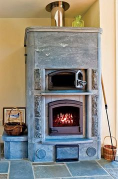 Soapstone Tulikivi stoves were added to the house for their aesthetic and radiant heat. This Old House