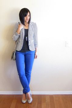 Blue button up, black and white striped blazer, black skinny jeans, and black…