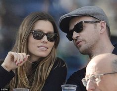 A List action: Justin Timberlake and his wife Jessica Biel watched Rafael Nadal and Novak Djokovic as they battled it out at the star-studded US Open final on Monday
