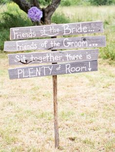 "Version of the ""pick a seat not a side"" wedding sign"