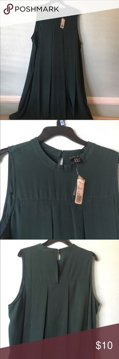 Plus size green dress Pretty green chiffon dress. NWT. Nice and flowy. I forgot it was in my closet and now it's too big for me. Comes with extra buttons. Great for wedding, work, or party! Forever 21 Dresses
