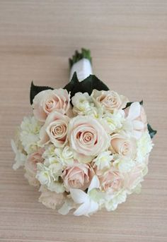 Bouquet with pale pink roses and white hydrangea.