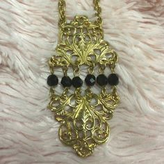 "GOLD TONE NECKLACE WITH BLACK STONES FILIGREE DISC Beautiful Filigree Medallion approximately 3"" by 2"" inches. Overall  length 24""inches gold rope chain. Jewelry Necklaces"