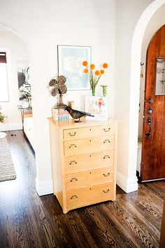 entry way, I love the fan and bird. Even the flowers. Not so sure about an entire dresser tho..