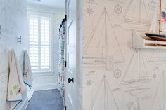 Nautical kid's bathroom with Ralph Lauren Chesapeake Wallpapered walls accented with a white shelf ledge with model sailboat.