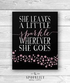 She Leaves a Little Sparkle Wherever She Goes typographic quote with pink digital sparkles. SpoonLily also carries this print with purple or gold
