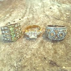 "Three ""diamond"" rings - Costume Jewelry Dress up any outfit with this glam costume jewelry. The two rings on the left are a size 6, the one on the right is a 6.5 or 7. Selling all three for $13. Make me an offer! Jewelry Rings"