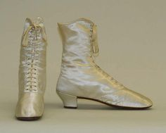 Women's boots, 1865. Small heel and narrow shape. Made of silk.