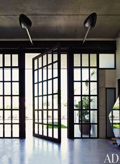 Tom Kundig of Olson Kundig Architects designed this industrial-style house/studio in Sitges, Spain.