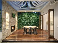 Outdoor fireplace, green wall and vergola.  Love it.  Toorak, Vic 3142