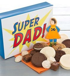 NEW! Send him Happy Father's Day treats with our delightful Super Dad Gift Box. He will love the tasty assortment of buttercream frosted vanilla cut-out cookies, snack size cookies and brownies, buttercream layered chocolate cookie sandwiches, sweet pretzel clusters and a hand decorated crunchy sugar cookie. 18 pieces. Kosher.