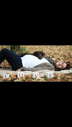 Cute fall/country pic with the leaves. With laying down it gives a different view of the belly too