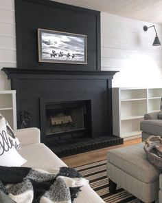 Loving this black fireplace by It is so fun to see a resurgence of black and white decor and design! What are your… fireplace, Grey Fireplace, Brick Fireplace Makeover, Paint Fireplace, Fireplace Remodel, Living Room With Fireplace, Fireplace Surrounds, Fireplace Design, Home Living Room, Living Room Decor