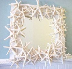 DIY starfish mirror. This would be cute with Sea Shells from our honeymoon